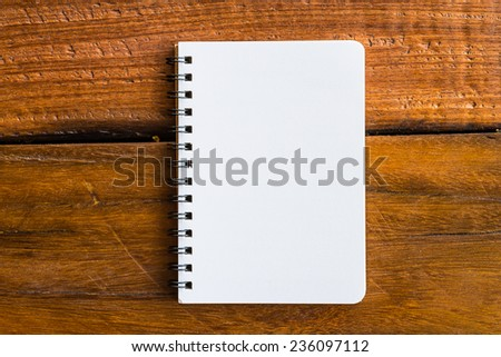 Note book paper on wooden background - Vintage effect style pictures - stock photo