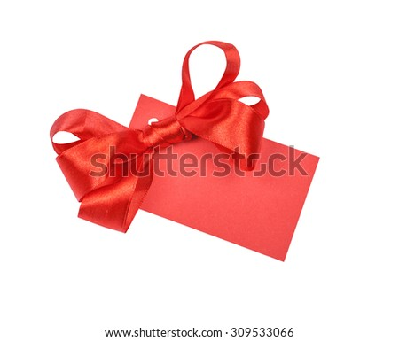Note card with red ribbon bow on white background - stock photo