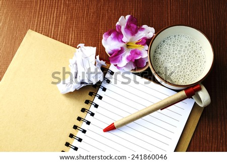 note for writing and drinking with garbage - stock photo