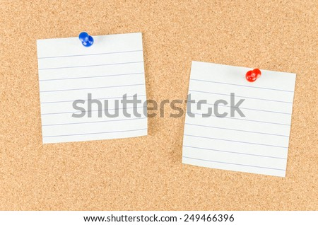 note pad and push pin isolated on cork board ready for your text. - stock photo