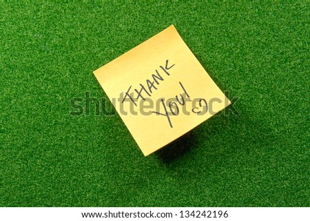 Note pad with thank you words. - stock photo