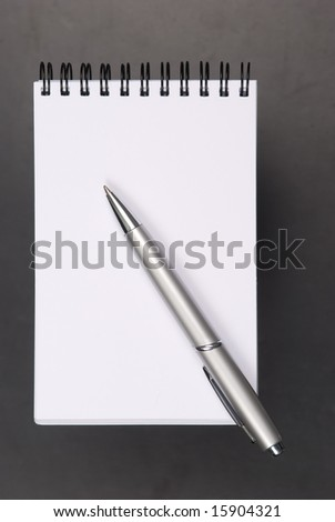 Note paper and opened notebook and the pencil - stock photo
