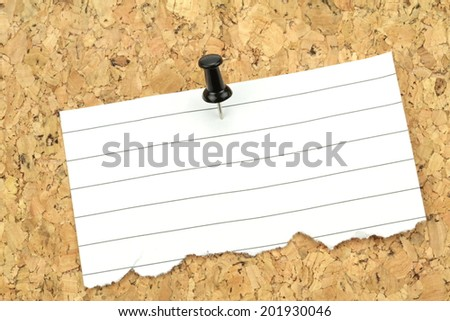 Note paper on cork board. Macro image. - stock photo
