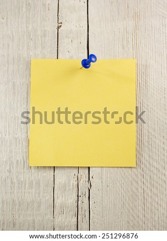 note paper on wooden background - stock photo