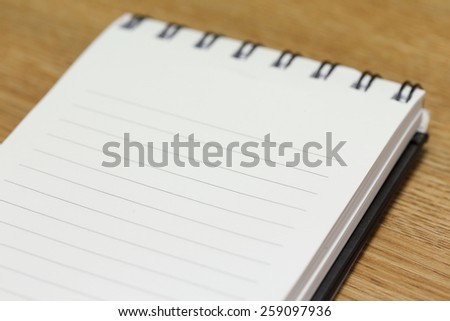 note paper with blank space on a wooden table - stock photo