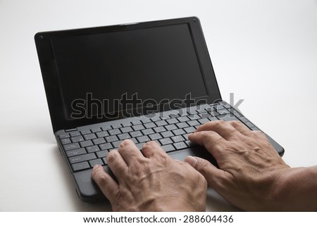 Note PC with Hands of Japanese People - stock photo