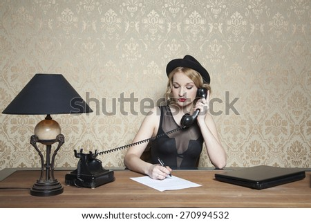 note, phone call and a complete focus - stock photo