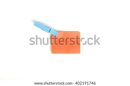 Note with a paper clip. Isolated on a white background - stock photo