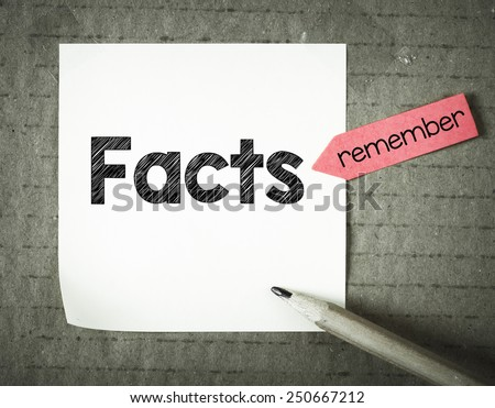 Note with facts. Note with facts and pencil on grunge background