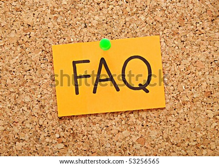 note with faq over brown cork background - stock photo