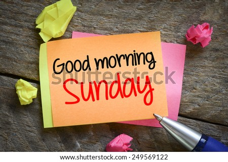 Note with Good morning sunday. Note with Good morning sunday on the wooden background with pen - stock photo