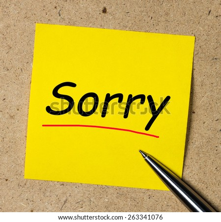 Note with sorry. Note with sorry and pencil - stock photo
