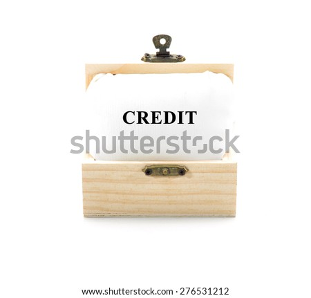 "Note with word ""CREDIT"" in wooden chest isolated on white background - stock photo"