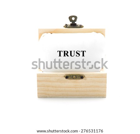 "Note with word ""TRUST"" in wooden chest isolated on white background - stock photo"
