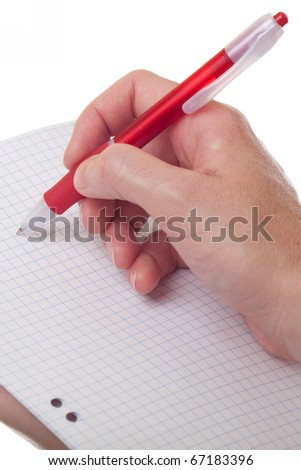 Notebook and a red pen in the hands of women isolated on white - stock photo