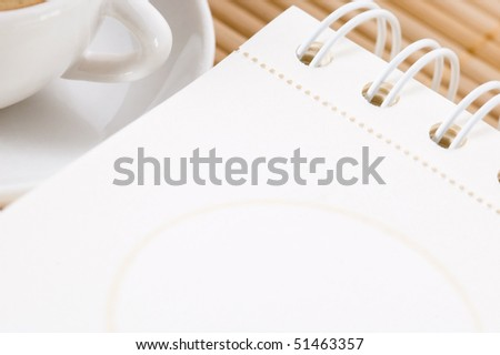 notebook and cup of coffee - stock photo