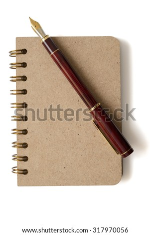 notebook and fountain pen isolated on white