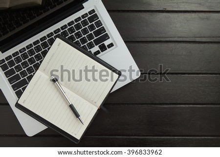 notebook and laptop computer on a wooden desk. Top view. great for your copy space - stock photo
