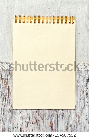 Notebook and linen fabric on the old wood background