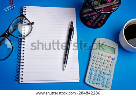 Notebook and office supply on background