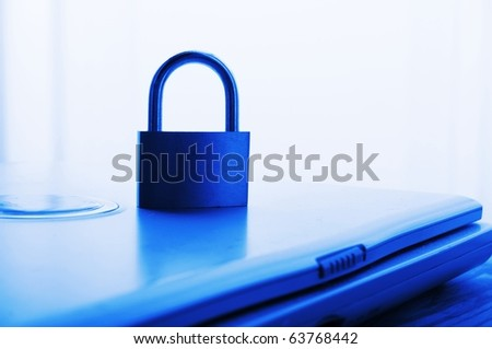 notebook and padlock showing internet or data security concept in blue - stock photo
