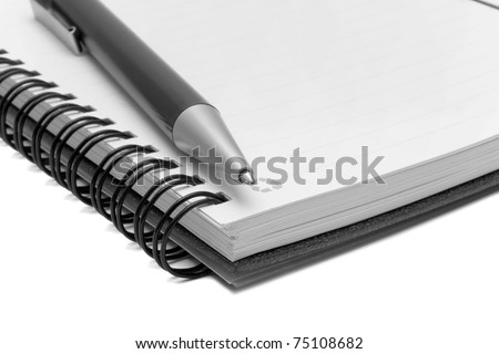 Notebook and pen in composition in black and white - stock photo