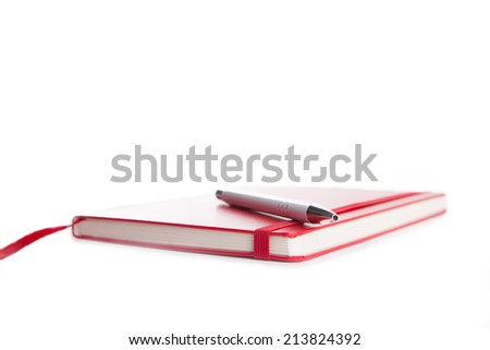 Notebook and pen in composition in red and white - stock photo