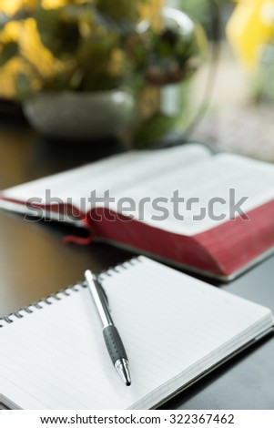 Notebook and Pen, Notebook and pen in composition on work table - stock photo