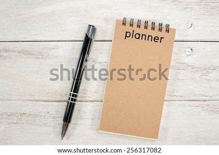 Notebook and pen on white desk. - stock photo