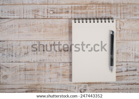 Notebook and pen on wood table for text and background - stock photo