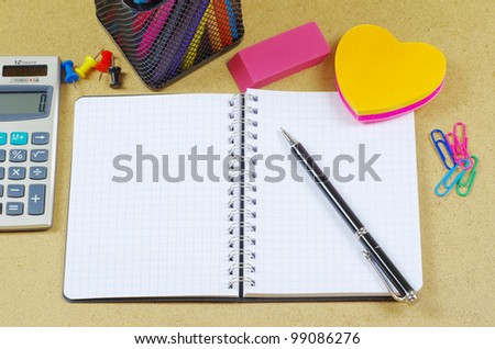 Notebook  and pen on wooden table