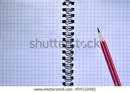 Notebook and pencil. - stock photo