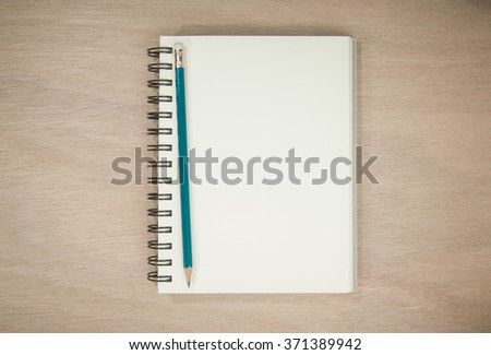 Notebook and Pencil on Old Wooden Table. - stock photo