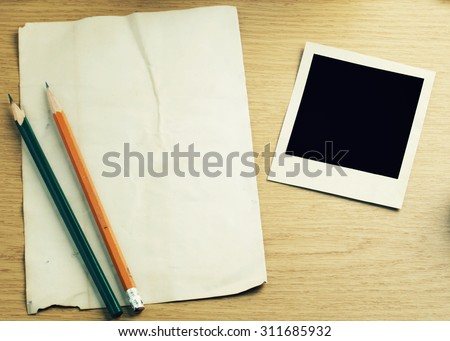 notebook and photo frame with space-vintage effect.