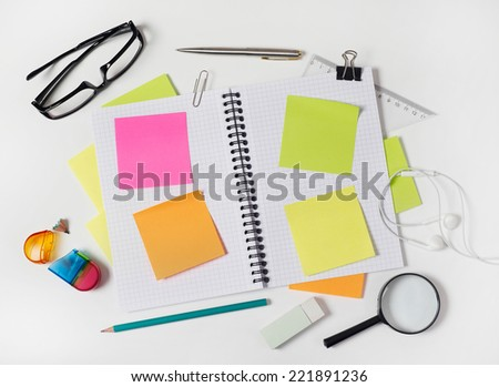 Notebook and supplies Blank notebook with supplies on white - stock photo