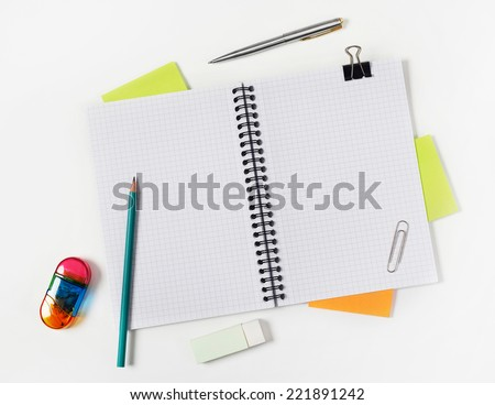 Notebook Blank notebook with supplies on white - stock photo