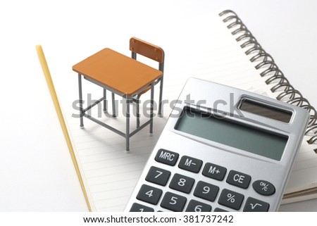 Notebook, calculator,  and miniature desk  / Study or student insurance image - stock photo