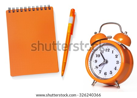 Notebook,calendar,diary, pen and alarm-clock, isolated on white background, bright orange color. Business wallpaper  . - stock photo