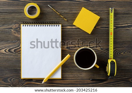 Notebook, coffee and technical tools on the table - stock photo