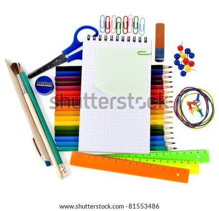 Notebook , colored pencils, back to school concept frame with copy space over white background  - stock photo