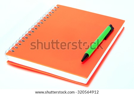 Notebook colorful and pen on white background - stock photo