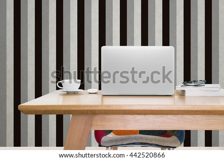 notebook computer and a cup of coffee on working table, notebook computer, mouse, coffee, books, glasses, modern chair, vintage background - stock photo