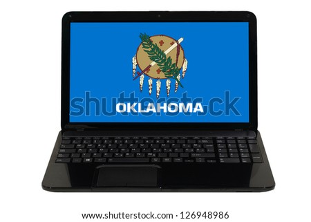 notebook computer with flag of us state of oklahoma - stock photo