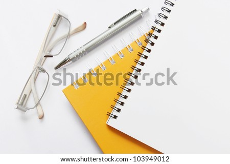 notebook glasses and pen on white - stock photo