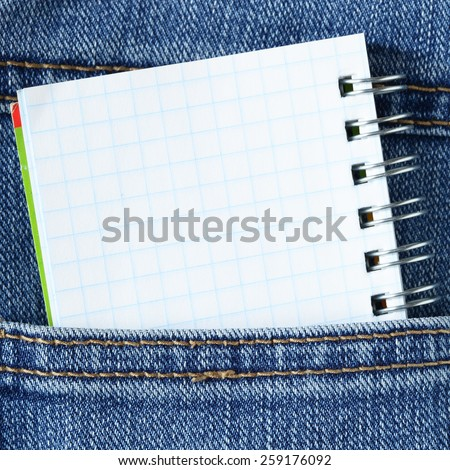 Notebook in pocket - space for your own text - stock photo