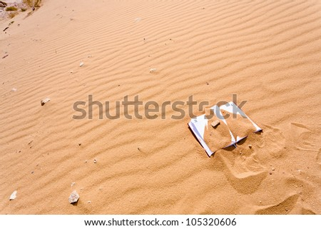 notebook in red sand dune of Wadi Rum desert, Jordan - stock photo