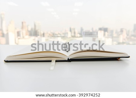 Notebook is opening with pen on top - stock photo