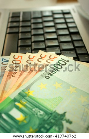 Notebook Keyboard with Euros paper money.