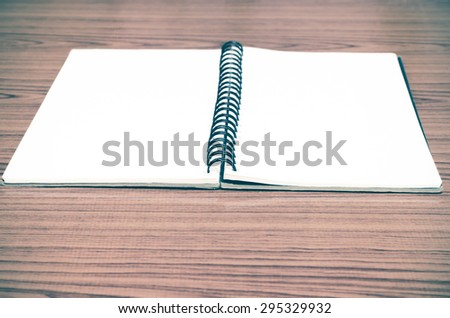 notebook line on wood background vintage style - stock photo