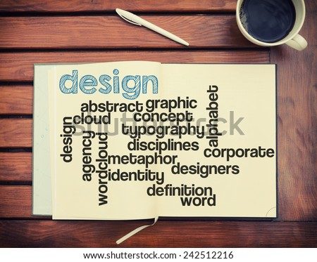 notebook lying on the table with the written words associated with the design , on the table are also cup of coffee, notes made in the form of the cloud of words  - stock photo